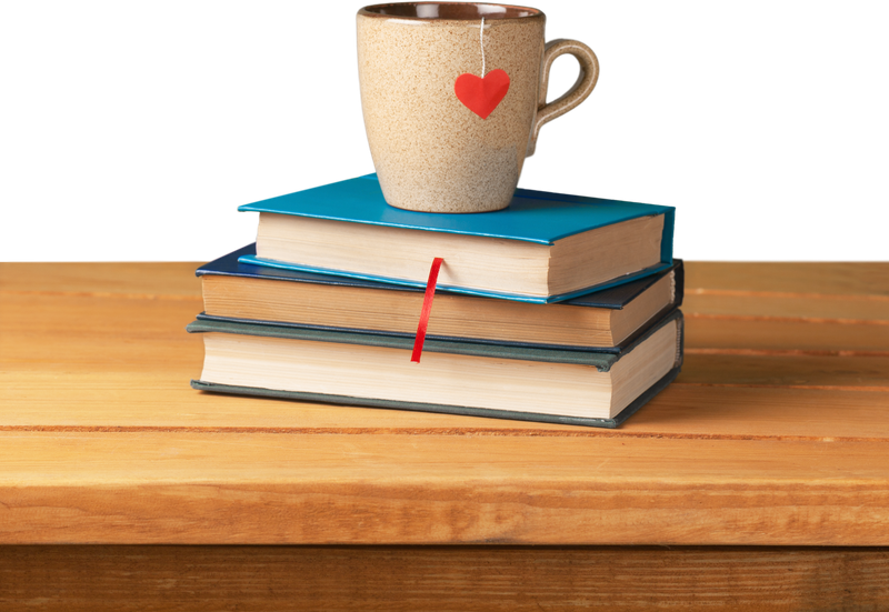 image of books with a cup of tea on top