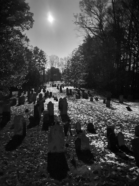 Black and white photo of a graveyard.
