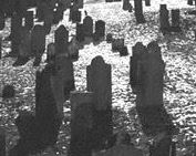 Black and white photo of grave stones.