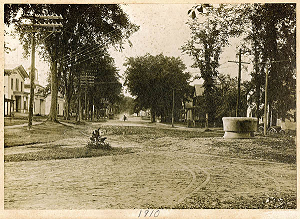 1910 photograph of Main Street in Williamsburg, Mass. looking northwest. Trolley tracks and watering trough are shown.