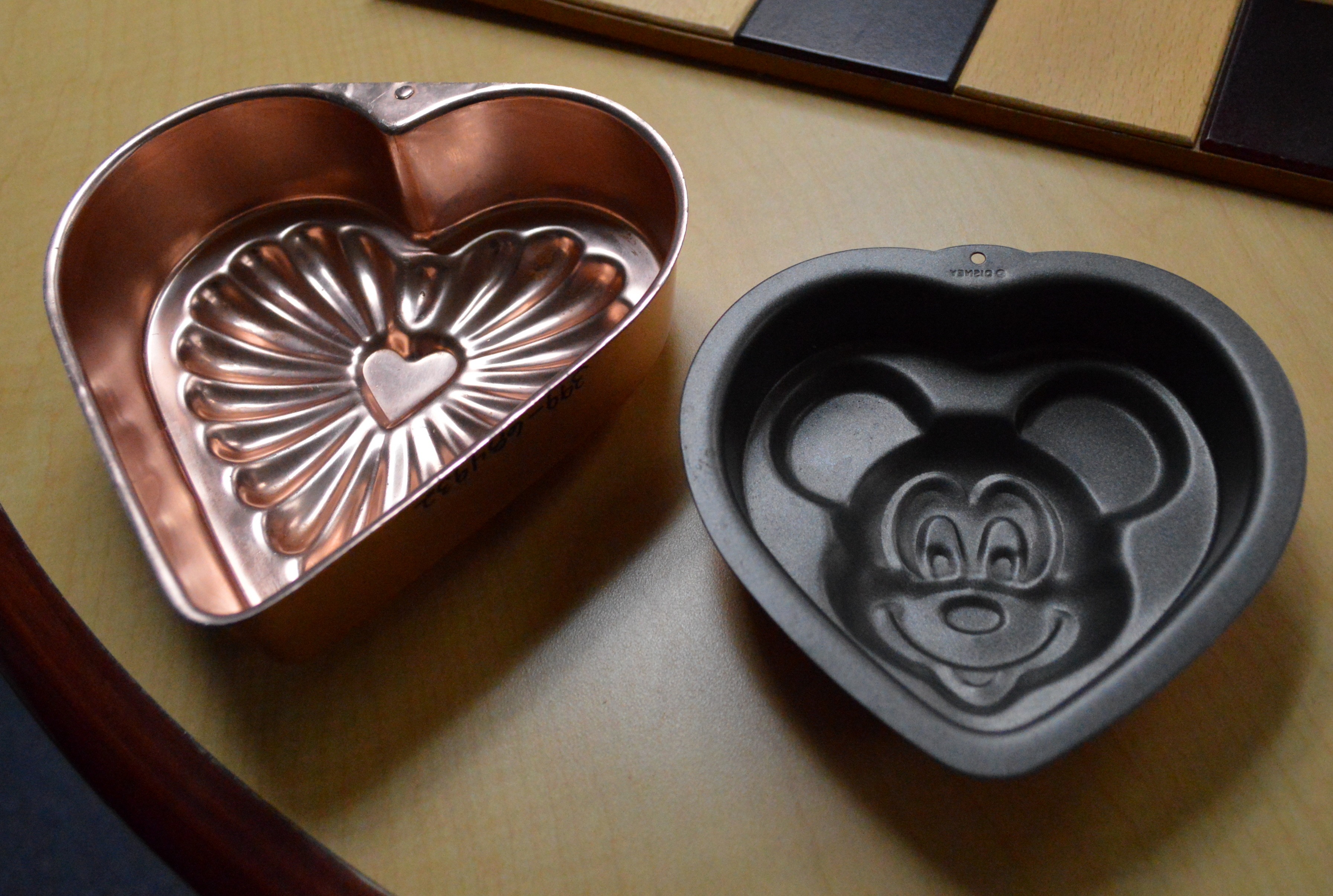 Image of a heart shaped baking pan and a Mickey Mouse head shaped baking pan