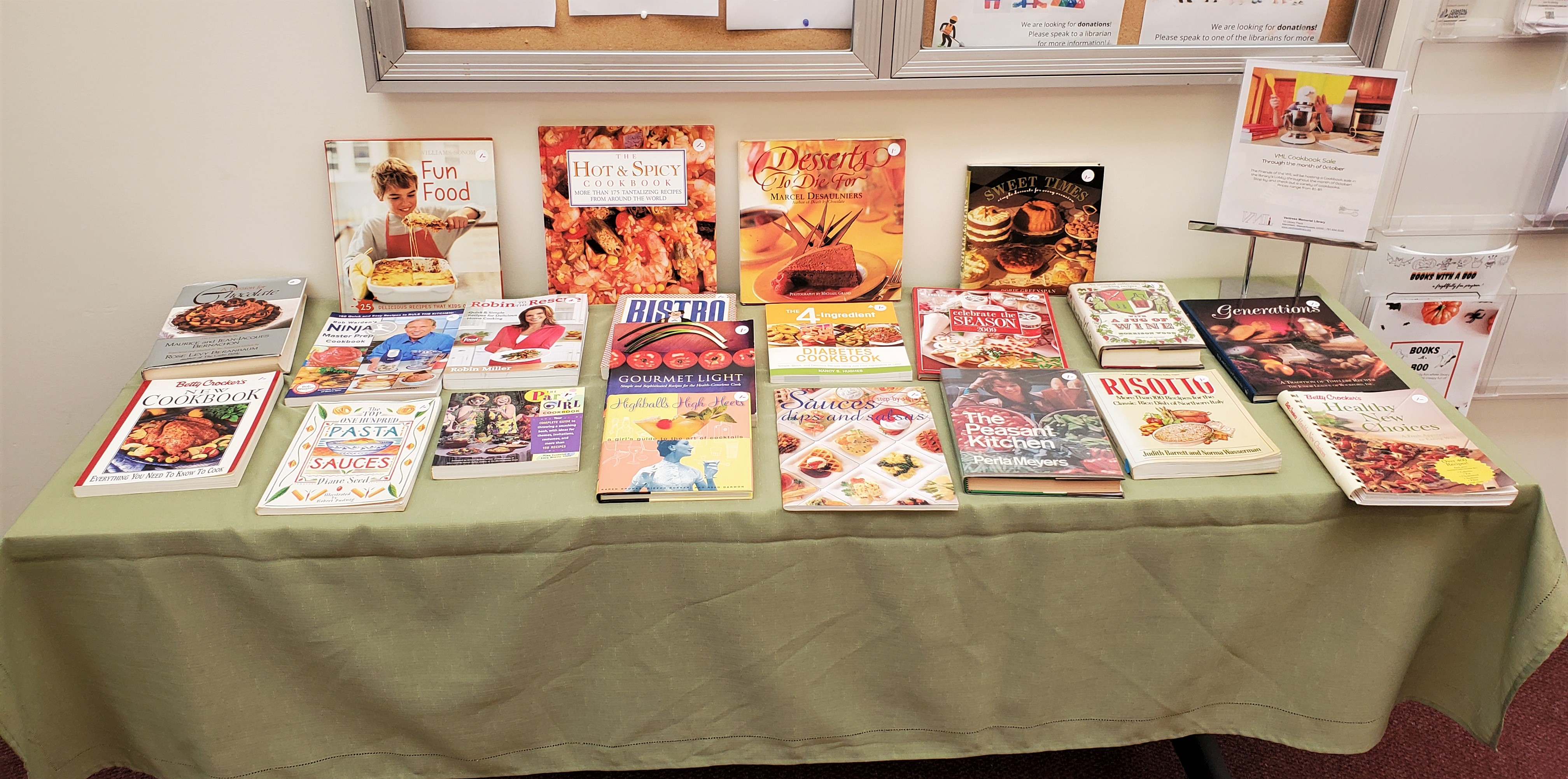 Photo of our cookbook sale: about 20 cookbooks displayed on a table.
